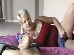 Granny\'s handjob while playing wet..