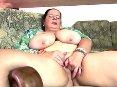 Chubby mature lady oiling up her tits..
