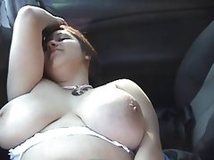 Bbw-girl outdoors masturbating in a car